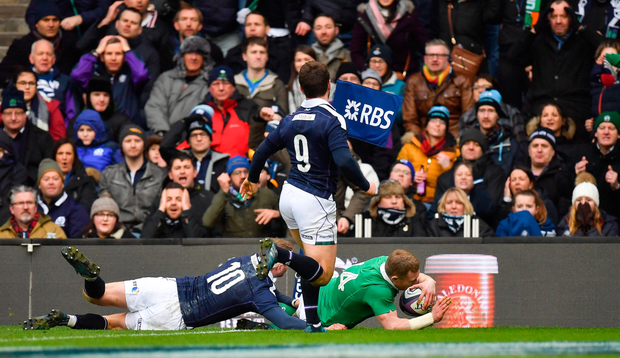 Keith Earls of Ireland skips past Finn Russell, left, and Greig Laidlaw of Scotland to score Ireland's first try during the RBS Six Nations Rugby Championship match between Scotland and Ireland at BT Murrayfield