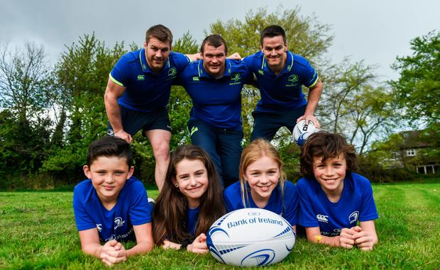 Leinster's Seán O'Brien, Jack McGrath and Jonathan Sexton at the launch of the Bank of Ireland Leinster Rugby Camps at St Mary's National School in Ranelagh, with Jake Walsh-Keane, Sophia Hickey, Catherine O'Connor and Alex O'Connor. Photo: Sportsfile