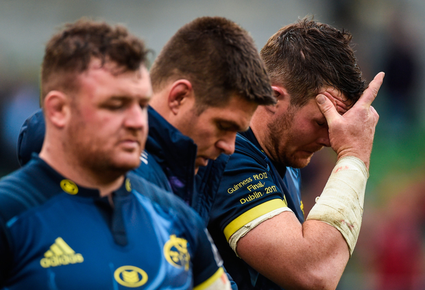 Dave Kilcoyne, Billy Holland and Peter O'Mahony of Munster react after the Guinness PRO12 final defeat. Photo: Sportsfile