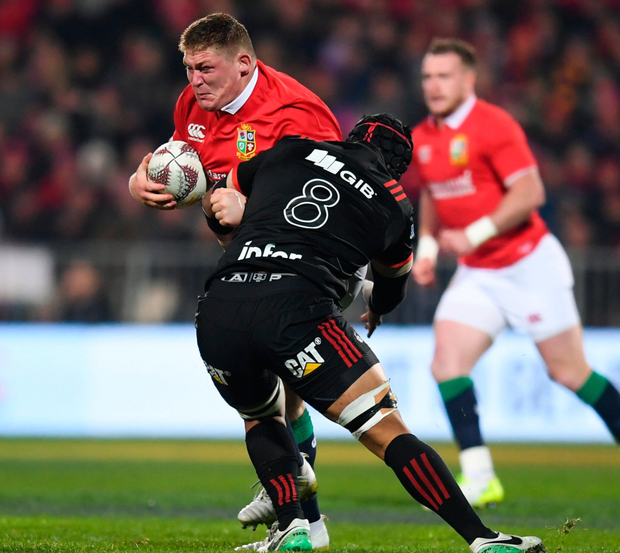 Tadhg Furlong of the British & Irish Lions is tackled by Jordan Taufua of Crusaders