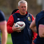 Warren Gatland oversees his players during Lions training at Beetham Park