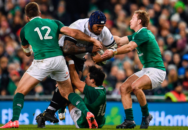 Nemani Nadolo of Fiji is tackled by (l-r) Stuart McCloskey, Joey Carbery and Kieran Marmion of Ireland during the Guinness Series match at the Aviva Stadium. Photo: Sportsfile