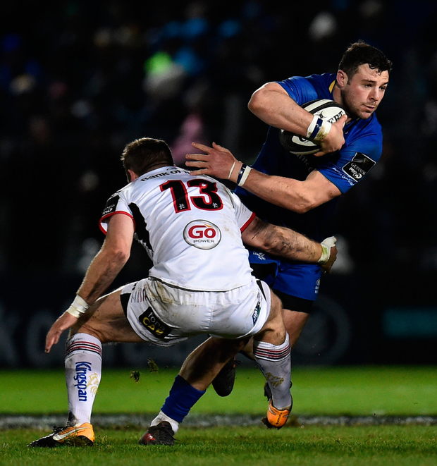 Robbie Henshaw in action for Leinster against Ulster's Darren Cave at the RDS.