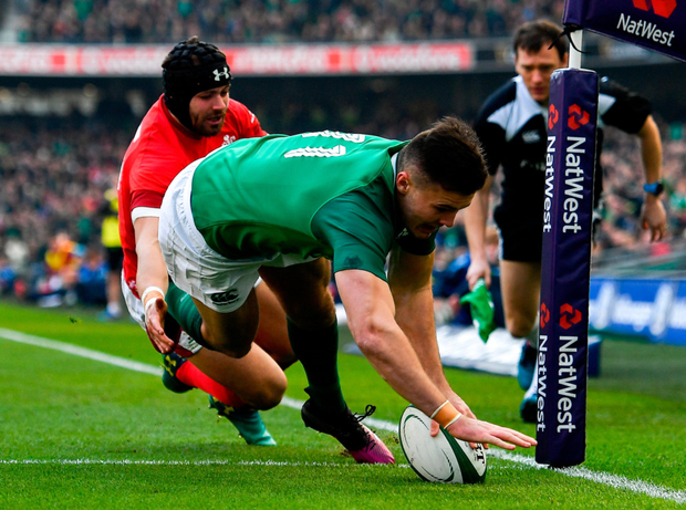 OPENER: Jacob Stockdale scores Ireland's s first try despite the efforts of Leigh Halfpenny of Wales at the Aviva Stadium on Saturday