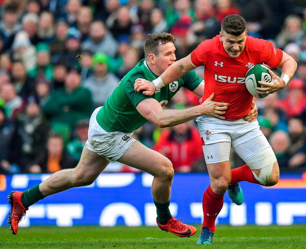 Ruled out: Ireland's Chris Farrell tackling Scott Williams of Wales