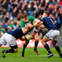 CENTRE STAGE: Garry Ringrose in action for Ireland against Scotland's Huw Jones during last year's Six Nations clash at Murrayfield. Pic: Sportsfile