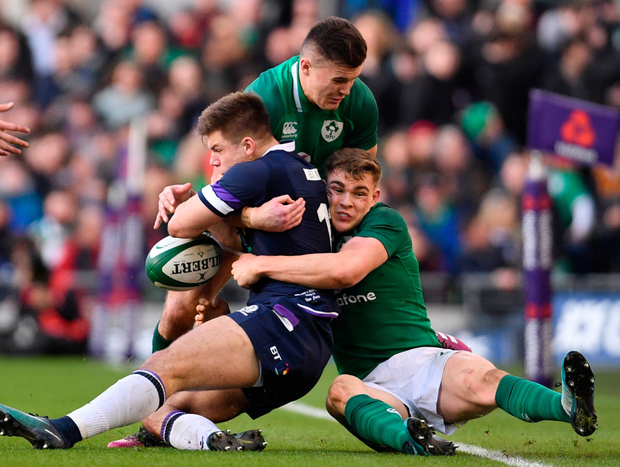 WORKING HARD: Scotland's Huw Jones is tackled by Jacob Stockdale
