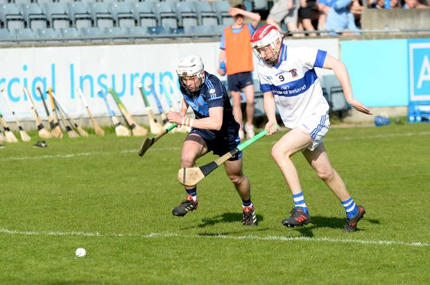 THE RACE IS ON: St Jude's Fionn O Riain Broin and St Vincent's Oisín Lanigan race for the sliotar during Saturday's Dublin SHC 'A' Group 1 encounter at Parnell Park. Photo: Justin Farrelly