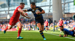 STAY AWAY: Leinster's Rob Kearney is tackled by Scarlets' Scott Williams. Photo: SPORTSFILE