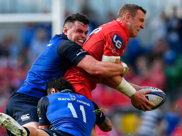 James Ryan of Leinster tackles Hadleigh Parkes of Scarlets during the Champions Cup semi-final at the Aviva Stadium