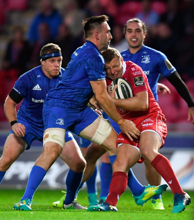 Hadleigh Parkes of Scarlets is tackled by Leinster's Jack Conan during the Guinness PRO14 match at Parc y Scarlets