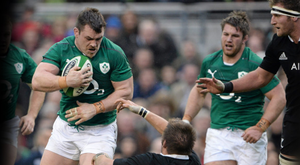Ireland's Cian Healy runs over New Zealand captain Richie McCaw during the Test in Dublin in November 2013. Pic: Sportsfile