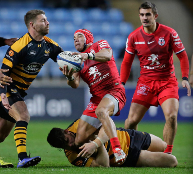 Toulouse's Cheslin Kolbe is tackled by Wasps' Ben Harris (bottom) and Willie le Roux during their Champions Cup clash at Ricoh Arena last month