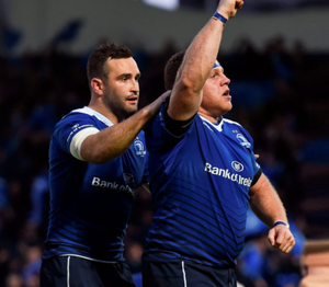 Leinster's Sean Cronin celebrates after scoring his side's third try with team-mate Dave Kearney, left, during the Guinness PRO12 play-off match between Leinster and Ulster at the RDS Arena