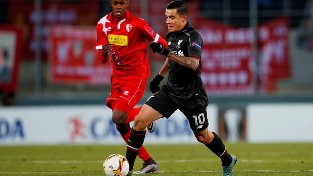 FC Sion's Geoffrey Mujangi Bia (left) in action against Liverpool's Philippe Coutinho