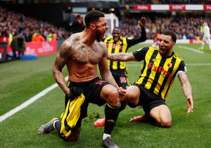 LATE HERO: Watford's Andre Gray celebrates scoring their second goal with Troy Deeney. Photo: Action Images via Reuters