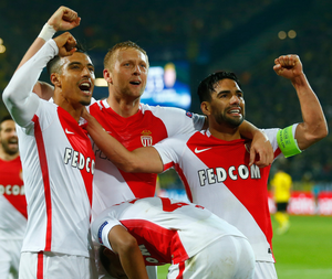 Monaco players celebrate on an evening where they took the initiative in their tie with Borussia Dortmund