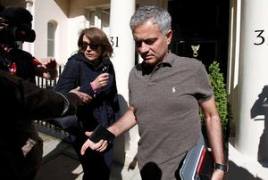 Jose Mourinho is pictured leaving his home in London yesterday