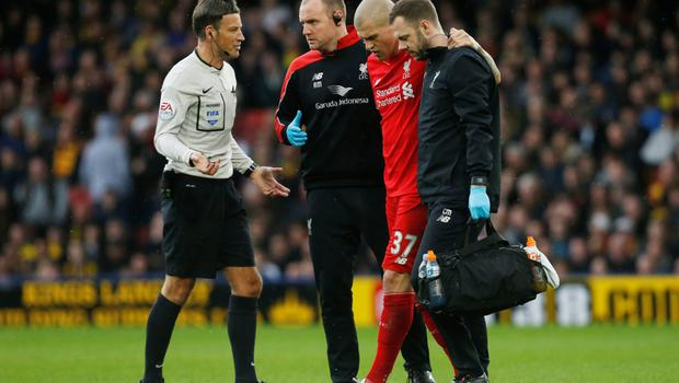 Liverpool's Martin Skrtel is escorted off the field during the Premier League defeat at Watford Photo:Reuters