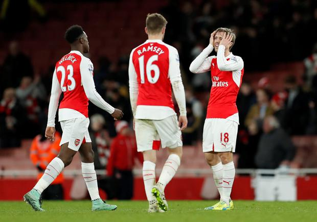 Arsenal's Danny Welbeck, Aaron Ramsey and Nacho Monreal look dejected after the Swansea defeat Photo: Reuters