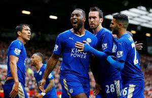 Leicester City's Wes Morgan celebrates scoring their equalising goal against Manchester United at Old Trafford.
