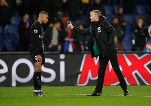 Manchester United caretaker manager Ole Gunnar Solskjaer consoles PSG's Kylian Mbappe after Wednesday night's Champions League win in Paris