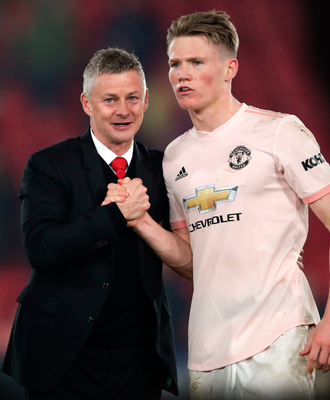 Ole Gunnar Solskjaer is pictured with Scott McTominay after the midweek win over Crystal Palace