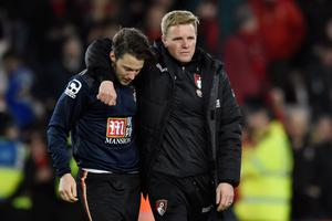 Harry Arter is consoled by Bournemouth manager Eddie Howe last season: Reuters / Toby Melville