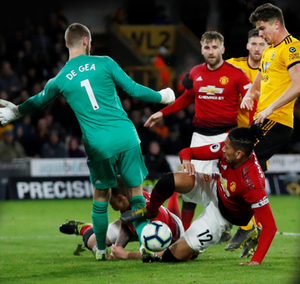 Manchester United defender Chris Smalling turns the ball into his own net in last night's Premier League defeat to Wolves