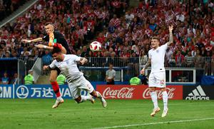 LEVELLER: Croatia's Ivan Perisic gets ahead of England's Kyle Walker to equalise in last night's World Cup semi-final. Pic: PA