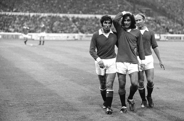DEVILS' DECLINE: Manchester United's George Best is helped off the field by teammates (r) Bobby Charlton and (l) Tony Dunne against Chelsea at Stamford Bridge in August 1971. Photo: Getty Images