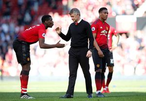 DEFEAT: Ole Gunnar Solksjaer is pictured with Paul Pogba (left) and Anthony Martial after the game. Pic: Reuters