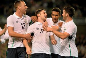 Robbie Brady, Republic of Ireland, celebrates scoring his side's fourth goal of the game with teammates David Meyler, Cyrus Christie, and Shane Long. International Friendly, Republic of Ireland v USA, Aviva Stadium, Lansdowne Road, Dublin. Picture credit: David Maher / SPORTSFILE