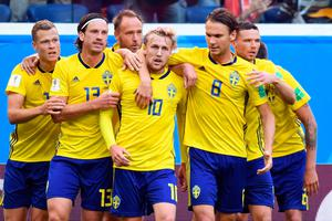 JOY: Emil Forsberg (centre) is congratulated by his team-mates in the World Cup last-16 win over Switzerland