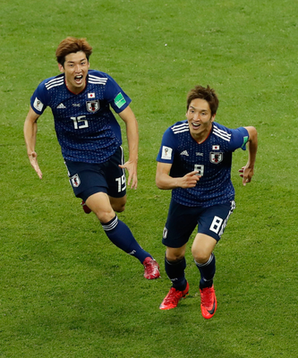 RISING SONS: Japan's Genki Haraguchi, right, celebrates with team-mate Yuya Osakohis after scoring his side's first goal during the last-16 clash with Belgium in Rostov