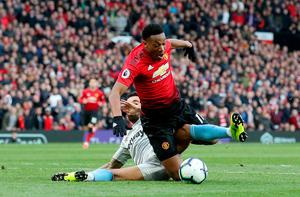 PIVOTAL MOMENT: Manchester United striker Anthony Martial is bundled over in the box by West Ham's Ryan Fredericks in Saturday's Premier League clash at Old Trafford. Photo: PA