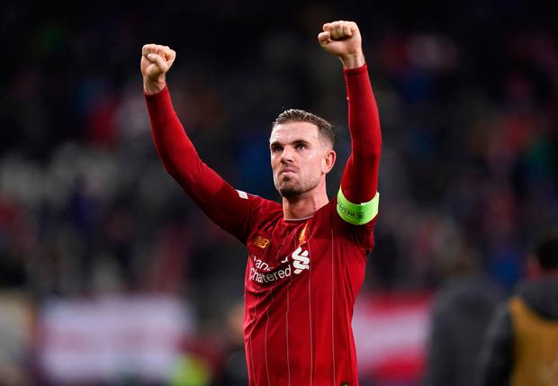 Liverpool's Jordan Henderson celebrates after the final whistle during the Champions League match at the Red Bull Arena, Salzburg