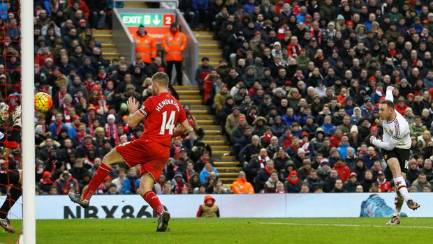 Wayne Rooney fires home the winner against Liverpool at Anfield.