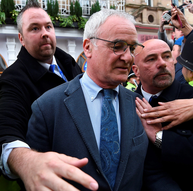 Leicester City manager Claudio Ranieri leaves the San Carlo Pizzeria in Leicester on Tuesday after winning the Premier League. Photo: PA