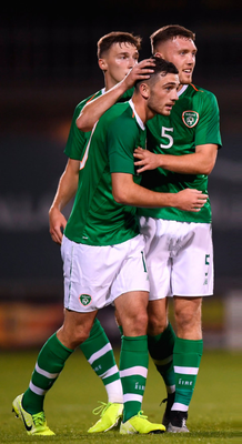 EURO STARS: Troy Parrott is congratulated by his Ireland U21 teammates Conor Masterson and Dara O'Shea after scoring in the European U21 Championship qualifying win over Armenia. Pic: Sportsfile