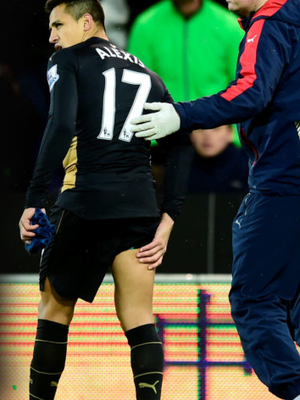 Arsenal star Alexis Sanchez leaves the action at Carrow Road on Sunday with a hamstring injury
