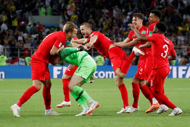 SPOT ON: England players celebrate Eric Dier's winning penalty kick against Colombia last Tuesday. Photo: REUTERS