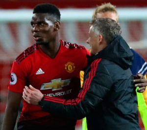 ON THE DOUBLE: Ole Gunnar Solskjaer celebrates with Paul Pogba at the end of yesterday's Premier League win over Huddersfield at Old Trafford. Photo: Getty
