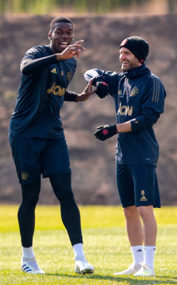 (l-r) Paul Pogba and Juan Mata share a light moment in training ahead of tonight's Champions League clash with Barcelona
