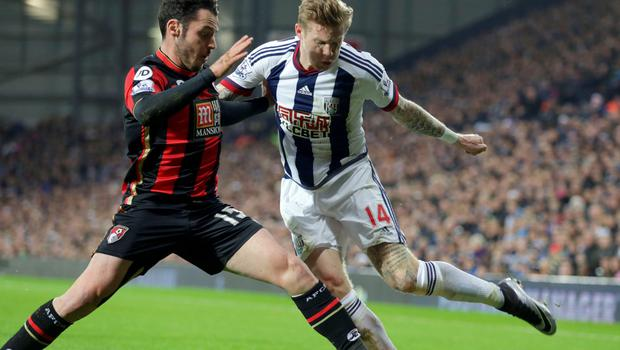 (l-r) West Brom's James McClean was sent-off for this tackle on Bournemouth's Adam Smith Photo:PA