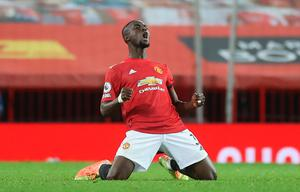 Winning run: Manchester United's Eric Bailly celebrates at the final whistle after the Premier League win over Aston Villa at Old Trafford