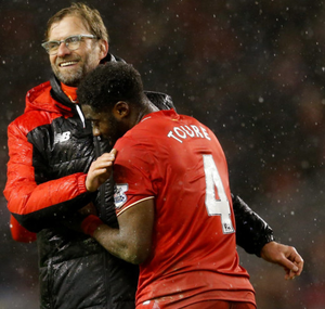 Liverpool defender Kolo Toure embraces his manager Jurgen Klopp at the end of Wednesday night's 3-3 Premier League draw with Arsenal at Anfield (Reuters)