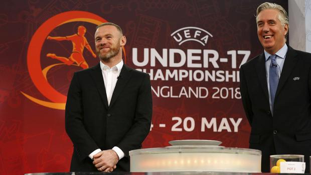 NO MORE: Wayne Rooney and John Delaney, in his UEFA role, performing the draw for the UEFA European U17 Championship Finals in England last year