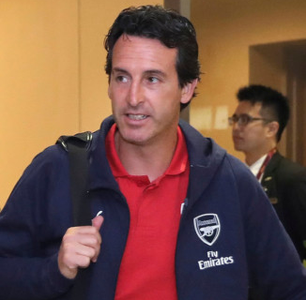 Determined: New Arsenal boss Unai Emery arriving in Singapore