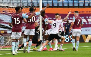 NO GOAL: Aston Villa's Orjan Nyland appears to carry the ball over the goal line but a goal wasn't awarded. Photo: REUTERS